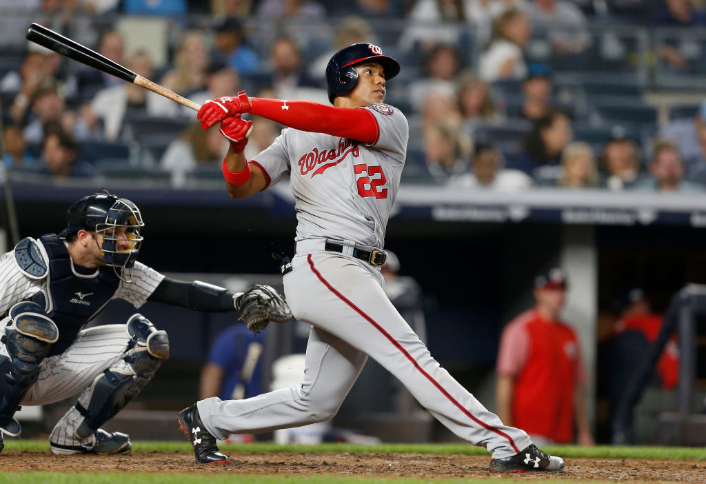 Juan Soto #22 of the Washington Nationals follows through on his seventh inning home run against the New York Yankees at Yankee Stadium on June 13, 2018 in the Bronx borough of New York City. The Nationals defeated the Yankees 5-4.  (Photo by Jim McIsaac/Getty Images)