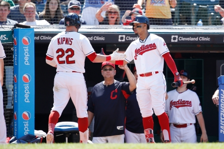 Jason Kipnis #22 of the Cleveland Indians is congratulated by Francisco Lindor #12 after hitting a solo home run in the eighth inning against the Detroit Tigers at Progressive Field on June 24, 2018 in Cleveland, Ohio. The Indians won 12-2. (Photo by Joe Robbins/Getty Images)