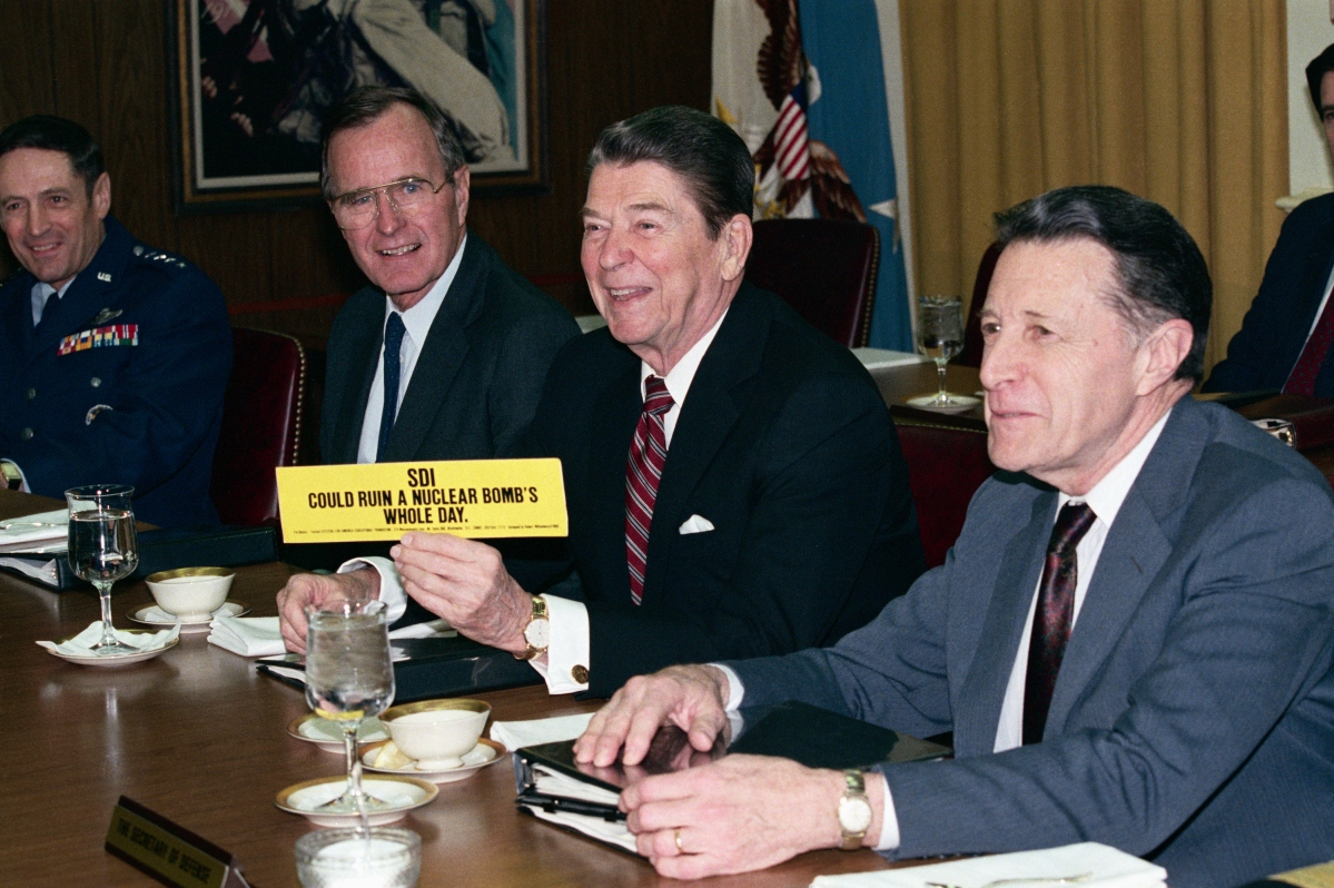President Ronald Reagan showing support for the Strategic Defense Initiative, nicknamed Star Wars. The bumper sticker reads SDI could ruin a nuclear bomb's whole day. (Getty)
