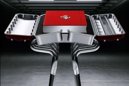 """Ferrari, Art Edition"" by Pino Allievi comes with a chromed-steel bookstand that looks like an engine. (Taschen)."