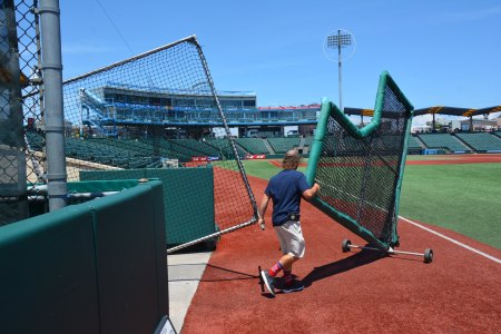 Max Colten wheels out more screens for batting practice at Municipal Credit Union Park in Coney Island. (Robert Marston)