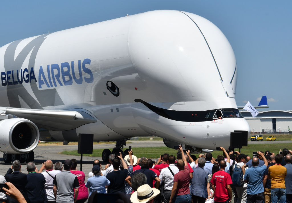 An Airbus 'BelugaXL' aircraft taxis in front of Airbus employees at Toulouse-Blagnac on July 19, 2018 (Photo by ERIC CABANIS / AFP)