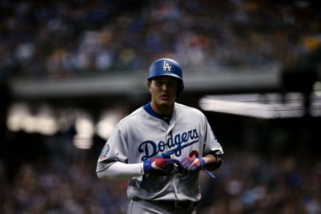 Manny Machado #8 of the Los Angeles Dodgers walks across the field in the seventh inning against the Milwaukee Brewers at Miller Park on July 21, 2018 in Milwaukee, Wisconsin. (Photo by Dylan Buell/Getty Images)