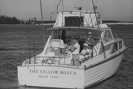 Teamster leader Jimmy Hoffa casting his reel into water off side of boat called The Yellow Rose II during fishing trip, w. his cohorts behind him, off coast of Miami, FL. (Photo by Frank Dandridge/Pix Inc./The LIFE Images Collection/Getty Images)