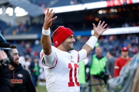 Quarterback Jimmy Garoppolo #10 of the San Francisco 49ers reacts after the 49ers defeated the Chicago Bears 15-14 at Soldier Field on December 3, 2017 in Chicago, Illinois. (Photo by Joe Robbins/Getty Images)