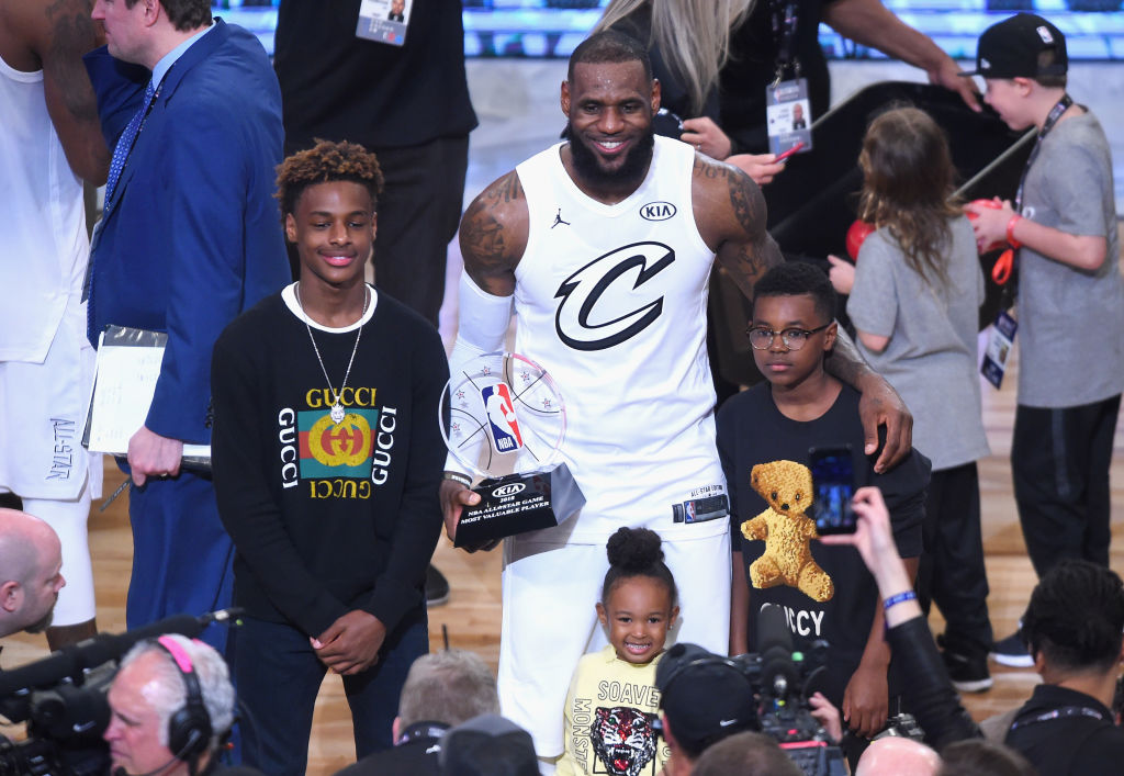 LeBron James Jr., LeBron James #23, Zhuri James and Bryce Maximus James pose for a photo with the All-Star Game MVP trophy during the NBA All-Star Game 2018 at Staples Center on February 18, 2018 in Los Angeles, California.  (Photo by Jayne Kamin-Oncea/Getty Images)