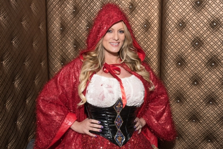 Stormy Daniels poses for a photo before her performance at Gossip Night Club on February 22, 2018 in Melville, New York. She wore this same outfit while performing at the Mardi Gras Gentlemens Club in Springfield, MA (Mike Pont/Getty Images)