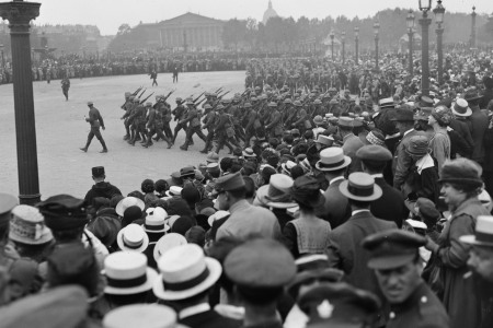 View over the crowd as they watch American troops march in the Place de la Concorde during a parade in celebration of US independence, Paris, France, July 4, 1918. (Lewis Hine/Interim Archives/Getty Images)