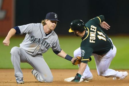 Dustin Fowler #11 of the Oakland Athletics gets caught attempting to steal second base tagged out by Gordon Beckham #1 of the Seattle Mariners in the bottom of the eighth inning at the Oakland Alameda Coliseum on May 23, 2018 in Oakland, California.  (Photo by Thearon W. Henderson/Getty Images)