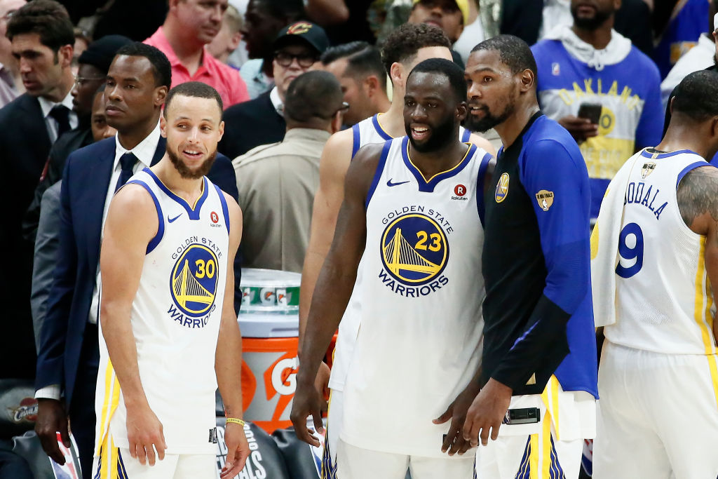 Stephen Curry #30 Draymond Green #23 and Kevin Durant #35 of the Golden State Warriors look on after defeating the Cleveland Cavaliers  in Game Four of the 2018 NBA Finals won 108-85 by the Golden State Warriors over the Cleveland Cavaliers at the Quicken Loans Arena on June 6, 2018 in Cleveland, Ohio. (Photo by Chris Elise/NBAE via Getty Images)