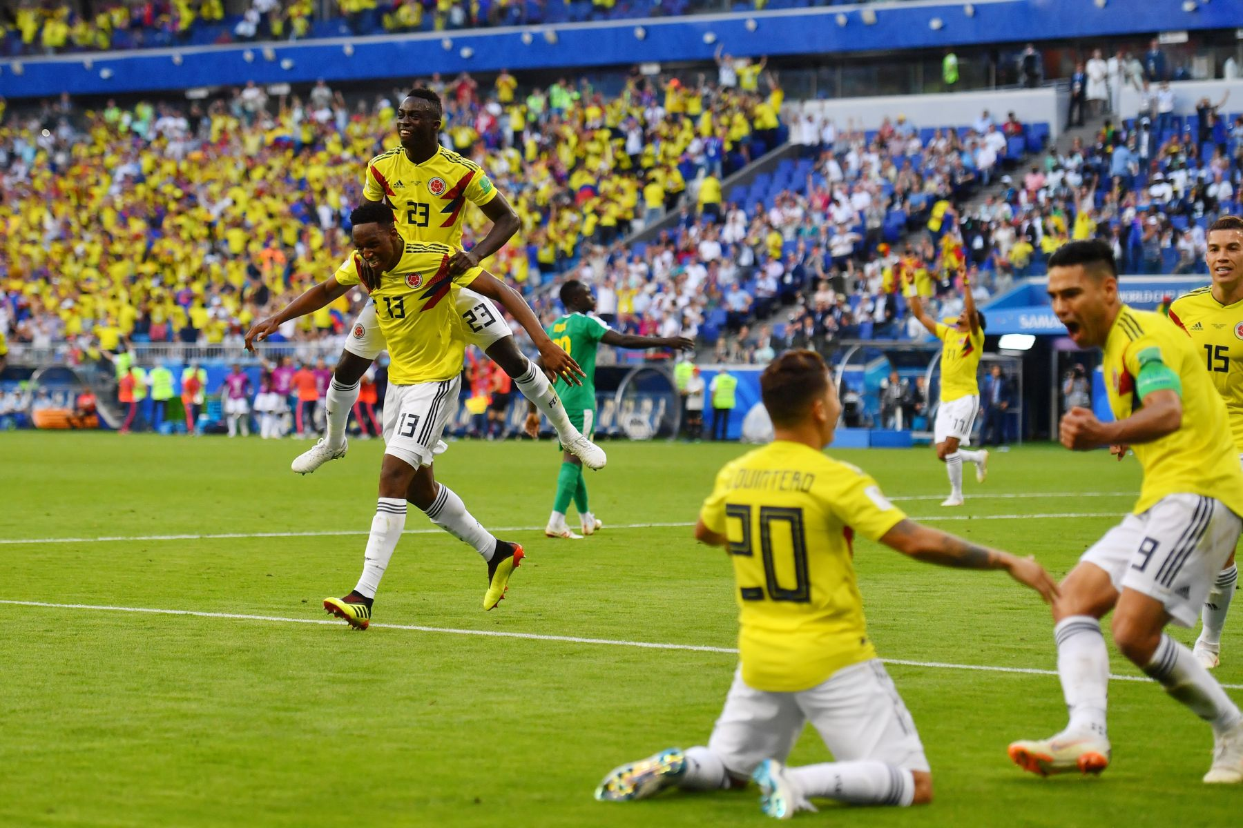 a52c7866b Colombia s defender Yerry Mina (L) celebrates with teammates after scoring  a goal during the