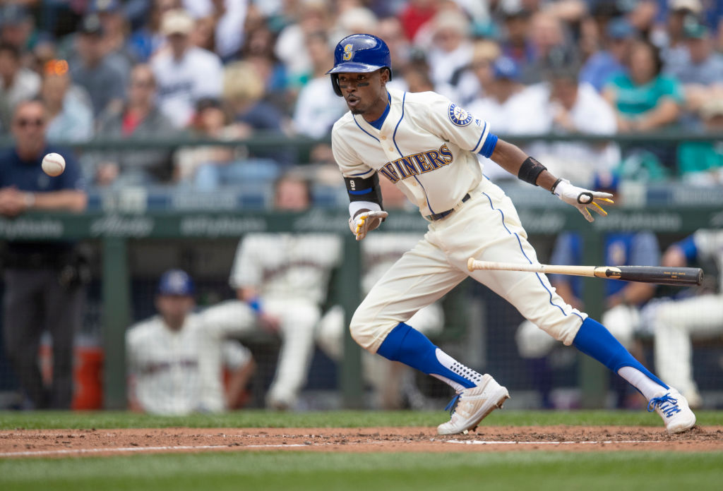 Dee Gordon #9 of the Seattle Mariners lays down a bunt during the sixth inning a game at Safeco Field on July 1, 2018 in Seattle, Washington. The Mariners won the game 1-0. Gordon was thrown out at first base. (Photo by Stephen Brashear/Getty Images)