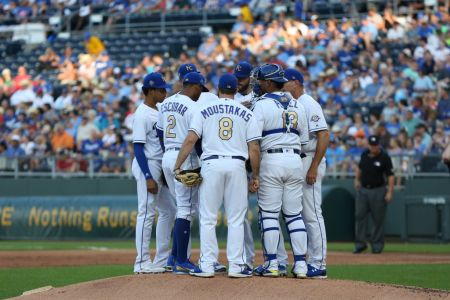 Kansas City Royals shortstop Alcides Escobar (2), third baseman Mike Moustakas (8), catcher Salvador Perez (13) and others huddle around struggling starting pitcher Jason Hammel (39) in the second inning of an MLB game between the Boston Red Sox and Kansas City Royals on July 6, 2018 at Kauffman Stadium in Kansas City, MO.  (Photo by Scott Winters/Icon Sportswire via Getty Images)