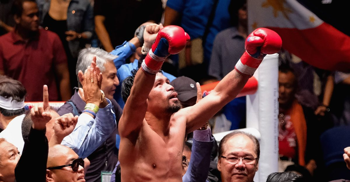 KUALA LUMPUR, MALAYSIA - JULY 15:  Philippine's Manny Pacquiao celebrated after winning fight with Argentina's Lucas Matthysse  during their World welterweight boxing championship title bout in Kuala Lumpur, Malaysia on July 15, 2018. (Photo by Mohd Samsul Mohd Said/Getty Images)