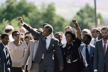 Nelson Mandela and his wife Winnie raise fists upon Mandela's release from Victor Verster prison on February 11, 1990 in Paarl. (ALEXANDER JOE/AFP/Getty Images)