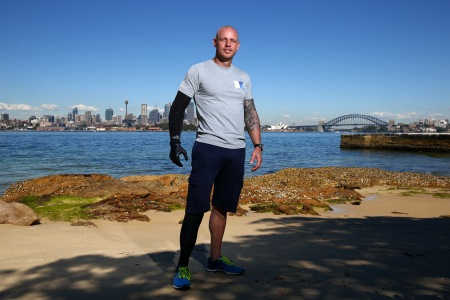 Paul de Gelder, poses on Sydney Harbour on November 13, 2013 in Sydney, Australia. Motivational speaker, author and Navy Reserve, Paul de Gelder, 36, lost both an arm and a leg when he was attacked by a male bull shark during an anti-terrorism exercise working as a Navy Clearance Diver with the Royal Australian Navy in Sydney Harbour in February 2009. De Gelder now travels Australia as a motivational speaker and shares his story to inspire others to overcome adversity. Paul is currently on location in South Australia monitoring the behaviour of Great White Sharks with scientists producing a documentary for Discovery Channel.  (Cameron Spencer/Getty Images)