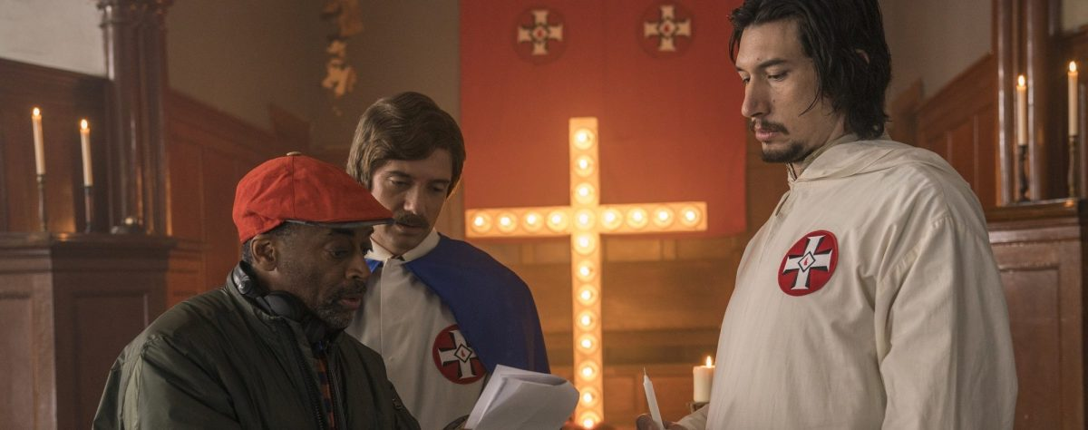 "(l-r.) Director Spike Lee, actors Topher Grace and Adam Driver on the set of Spike Lee's ""BlacKkKlansman."" (David Lee / Focus Features)"