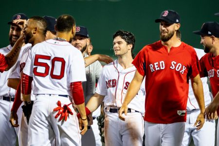 BOSTON, MA - AUGUST 5: Andrew Benintendi #16 of the Boston Red Sox reacts with teammates after hitting the game winning walk off single during the tenth inning of a game against the New York Yankees on August 5, 2018 at Fenway Park in Boston, Massachusetts. (Photo by Billie Weiss/Boston Red Sox/Getty Images)