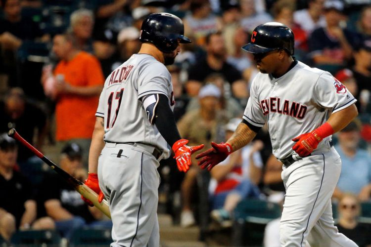 CHICAGO, IL - AUGUST 11: Jose Ramirez #11 of the Cleveland Indians (R) is congratulated by Yonder Alonso #17 after hitting a home run against the Chicago White Sox during the sixth inning at Guaranteed Rate Field on August 11, 2018 in Chicago, Illinois.  (Photo by Jon Durr/Getty Images)