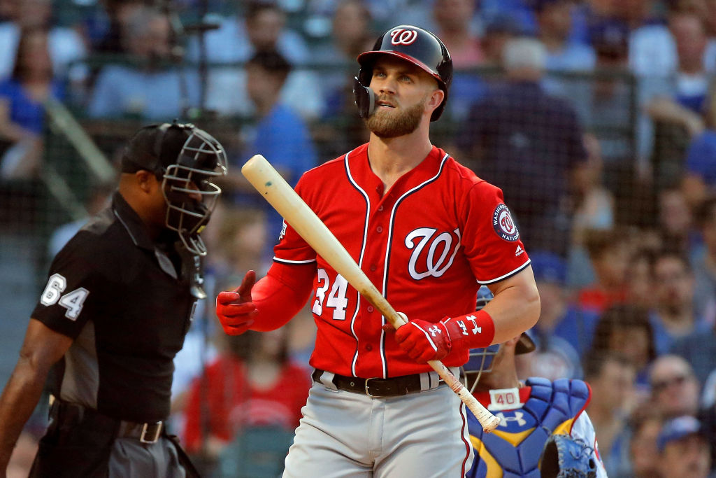 Bryce Harper #34 of the Washington Nationals reacts after a swinging strike two against the Chicago Cubs during the first inning at Wrigley Field on August 12, 2018 in Chicago, Illinois. The Chicago Cubs won 4-3. (Photo by Jon Durr/Getty Images)