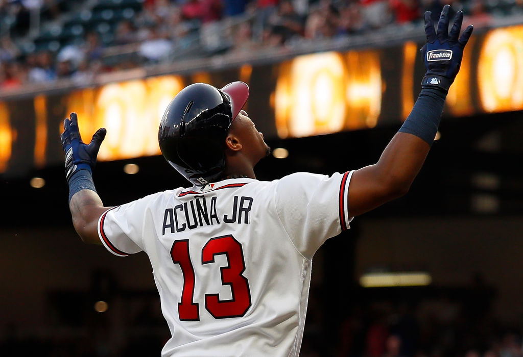 Ronald Acuna Jr. #13 of the Atlanta Braves reacts after hitting a solo homer to lead off game two of a doubleheader against the Miami Marlins at SunTrust Park on August 13, 2018 in Atlanta, Georgia. (Photo by Kevin C. Cox/Getty Images)