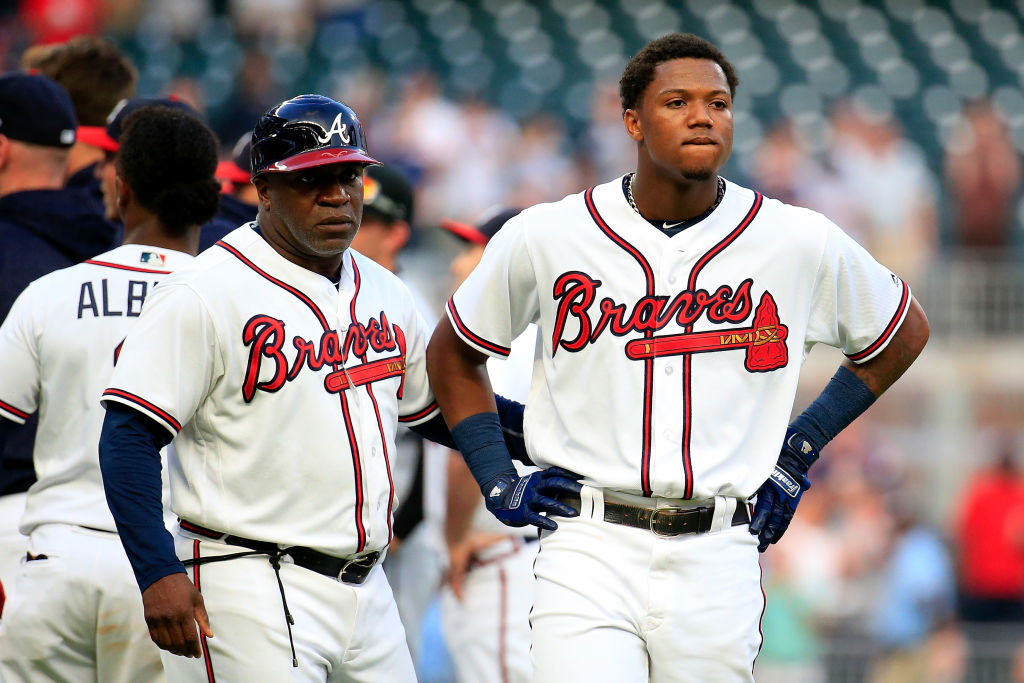 ATLANTA, GA - AUGUST 15: Ronald Acuna Jr. #13 (R) of the Atlanta Braves reacts to being hit by the first pitch of the game against the Miami Marlins at SunTrust Park on August 15, 2018 in Atlanta, Georgia. (Photo by Daniel Shirey/Getty Images)