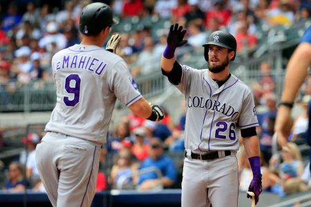 ATLANTA, GA - AUGUST 19: DJ LeMahieu #9 of the Colorado Rockies celebrates a solo home run with David Dahl #26 during the third inning against the Atlanta Braves at SunTrust Park on August 19, 2018 in Atlanta, Georgia. (Photo by Daniel Shirey/Getty Images)