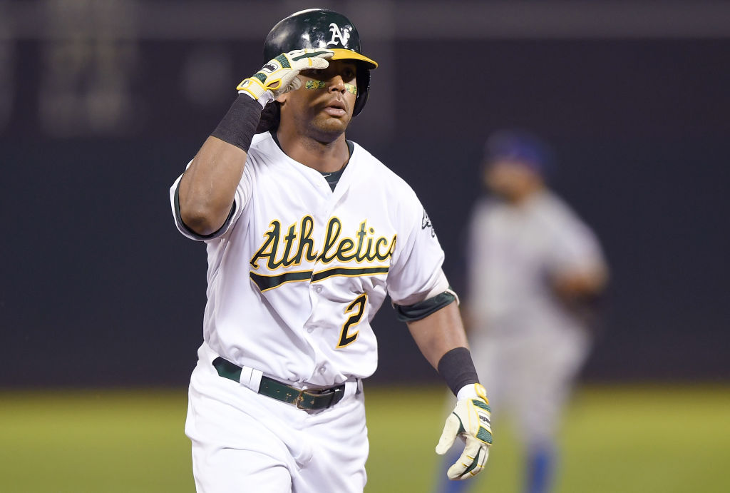OAKLAND, CA - AUGUST 20:  Khris Davis #2 of the Oakland Athletics salutes his teammates while trotting around the bases after hitting a solo home run against the Texas Rangers in the bottom of the third inning at Oakland Alameda Coliseum on August 20, 2018 in Oakland, California.  (Photo by Thearon W. Henderson/Getty Images)