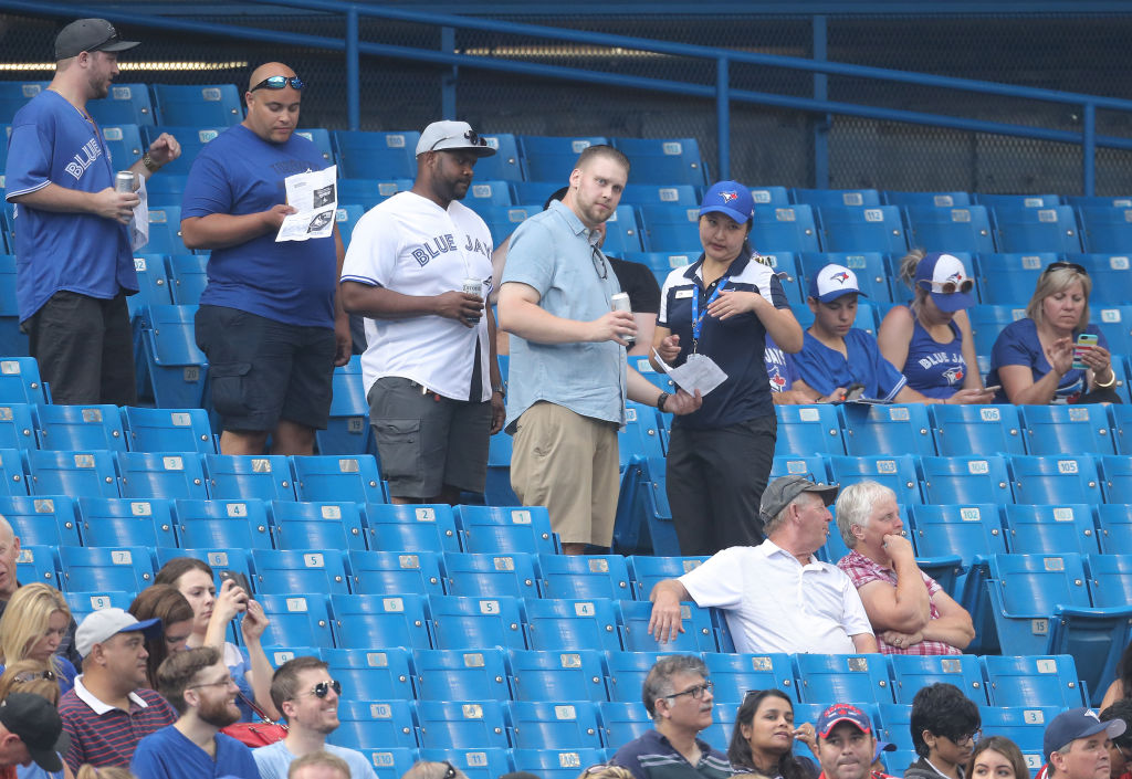 TORONTO, ON - AUGUST 7: Fans of the Toronto Blue Jays line up in the aisle as an usher directs them to their seats during MLB game action against the Boston Red Sox at Rogers Centre on August 7, 2018 in Toronto, Canada. (Photo by Tom Szczerbowski/Getty Images)