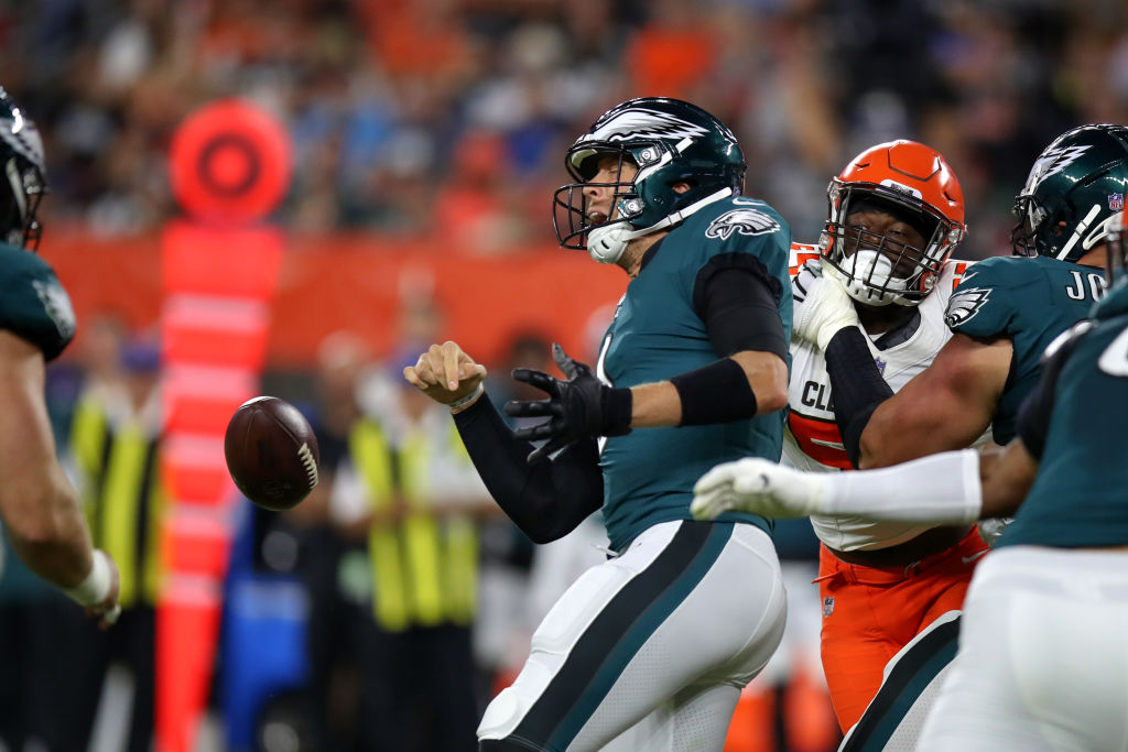 CLEVELAND, OH - AUGUST 23: Philadelphia Eagles quarterback Nick Foles (9) fumbles the football during the first quarter of the National Football League preseason game between the Philadelphia Eagles and Cleveland Browns on August 23, 2018, at FirstEnergy Stadium in Cleveland, OH. Cleveland defeated Philadelphia 5-0. (Photo by Frank Jansky/Icon Sportswire via Getty Images)