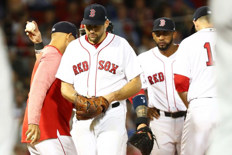 BOSTON, MA - AUGUST 21: Nathan Eovaldi #17 of the Boston Red Sox is taken out of the game by Manager Alex Cora in the sixth inning of a game against the Cleveland Indians at Fenway Park on August 21, 2018 in Boston, Massachusetts. (Photo by Adam Glanzman/Getty Images)