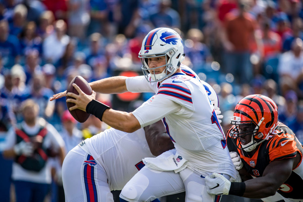 ORCHARD PARK, NY - AUGUST 26:  Josh Allen #17 of the Buffalo Bills is sacked by Carl Lawson #58 of the Cincinnati Bengals during the first quarter of a preseason game at New Era Field on August 26, 2018 in Orchard Park, New York.  (Photo by Brett Carlsen/Getty Images)