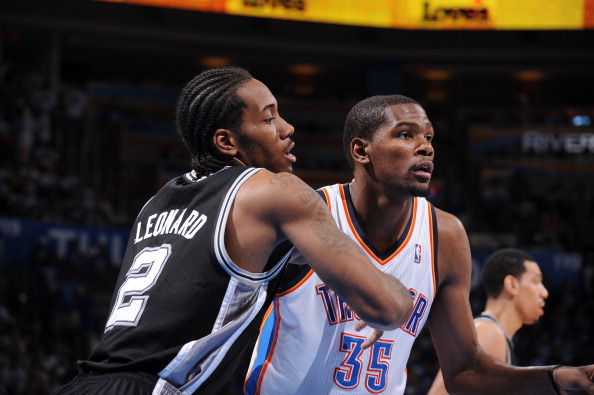 OKLAHOMA CITY, OK - JUNE 2: Kevin Durant #35 of the Oklahoma City Thunder battles for position against Kawhi Leonard #2 of the San Antonio Spurs in Game Four of the Western Conference Finals during the 2012 NBA Playoffs on June 2, 2012 at the Chesapeake Energy Arena in Oklahoma City, Oklahoma. (Photo by Andrew D. Bernstein/NBAE via Getty Images)