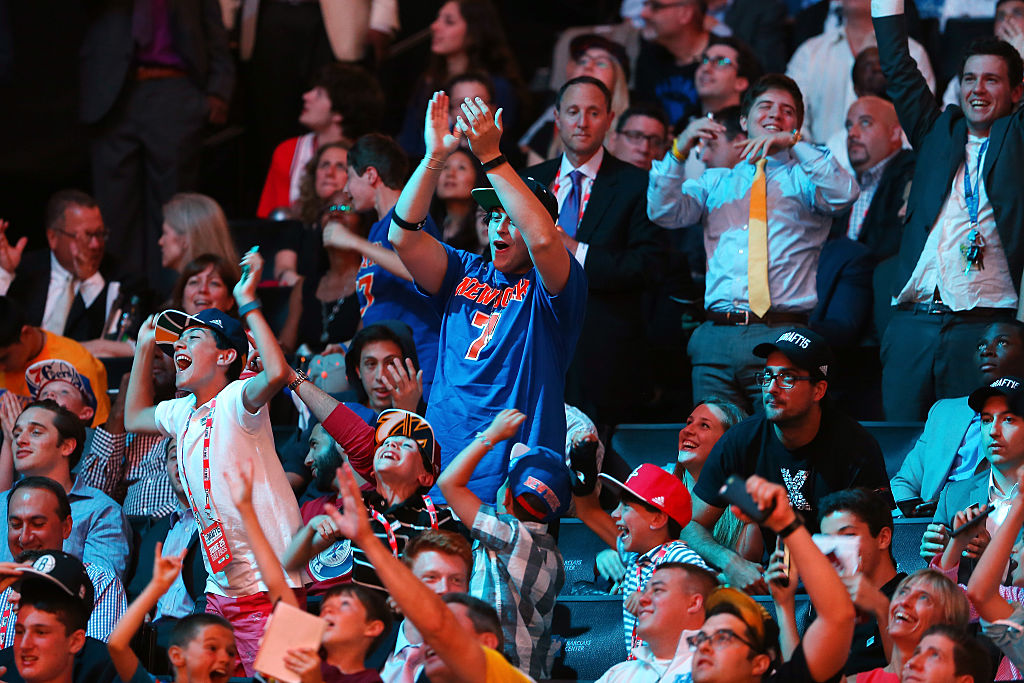 NEW YORK, NY - JUNE 25: Fans cheer after Kristaps Porzingis was selected fourth overall by the New York Knicks in the First Round of the 2015 NBA Draft at the Barclays Center on June 25, 2015 in the Brooklyn borough of  New York City. (Photo by Elsa/Getty Images)