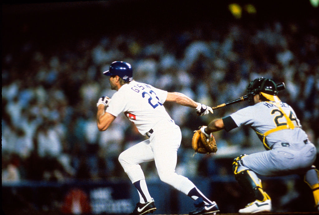 Kirk Gibson #23 of the Los Angeles Dodgers swing and hits a game winning pitch-hit home run in the bottom of the ninth inning of game one against the Oakland Athletics during the 1988 World Series, October 15, 1988 at Dodger Stadium in Los Angeles, California. The Dodgers won the series 4-1. (Focus on Sport/Getty Images)