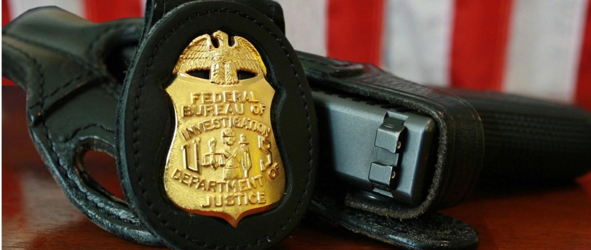 FBI badge and sidearm. (Photo: Wikimedia)