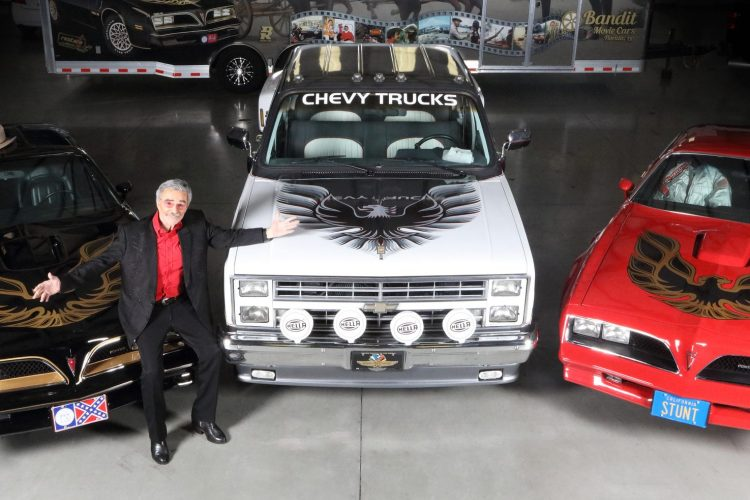 Burt Reynolds with a trio of his personal cars. (Barrett Jackson)