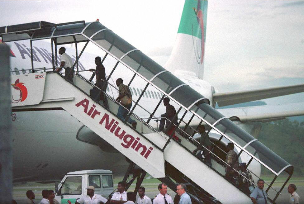 An Air Niugini flight in Port Moresby, Papua New Guinea, (PNG) 21 March. An Air Niugini Flight Crash Landed onto the waters of Micronesia September 28, and all onboard survived.  (Photo by STR/AFP/Getty Images)