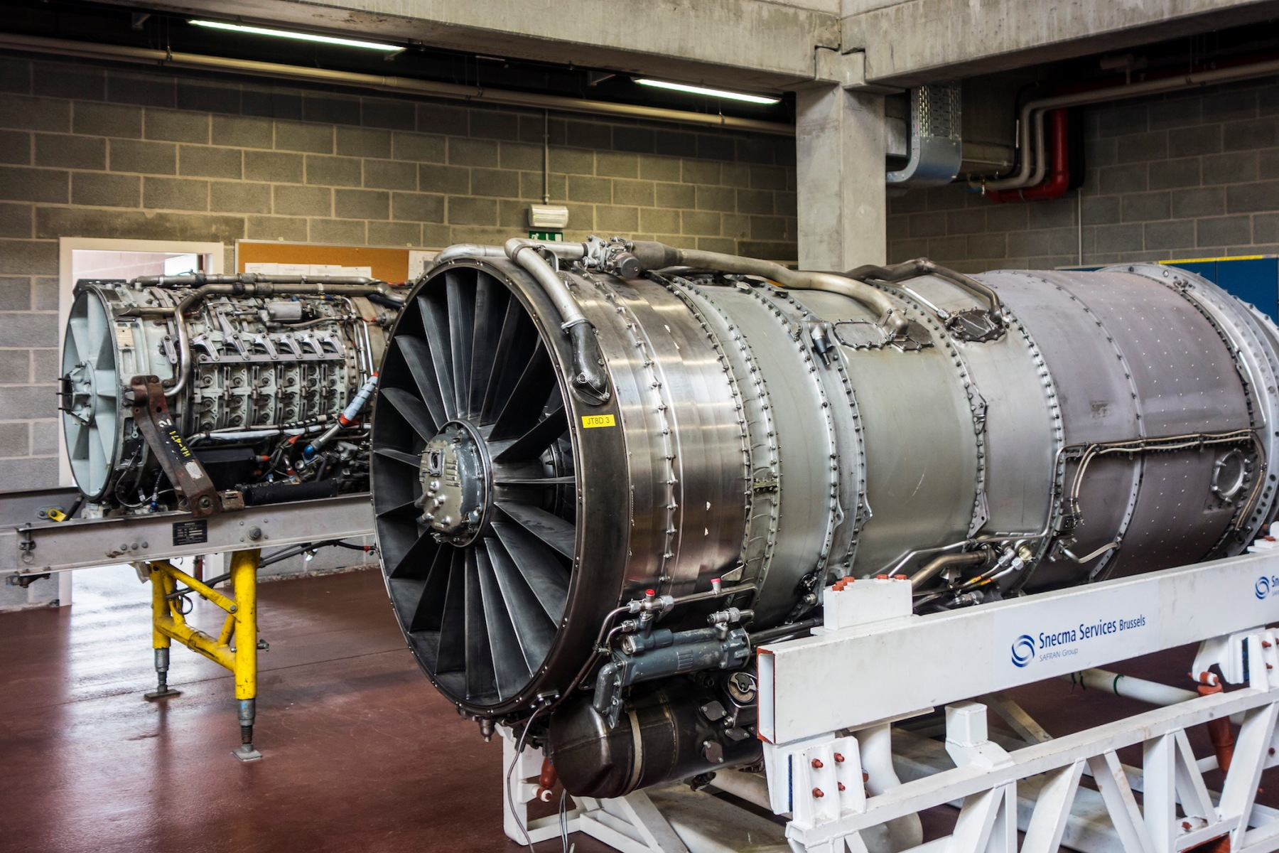 Jet engines for teaching purposes in workshop of the Vlaams Luchtvaartopleidingscentrum / VLOC / Flemish aviation training center in Ostend, Belgium. The company Magnix hopes to soon replace plane engines with an electric motor. (Photo by: Arterra/UIG via Getty Images)