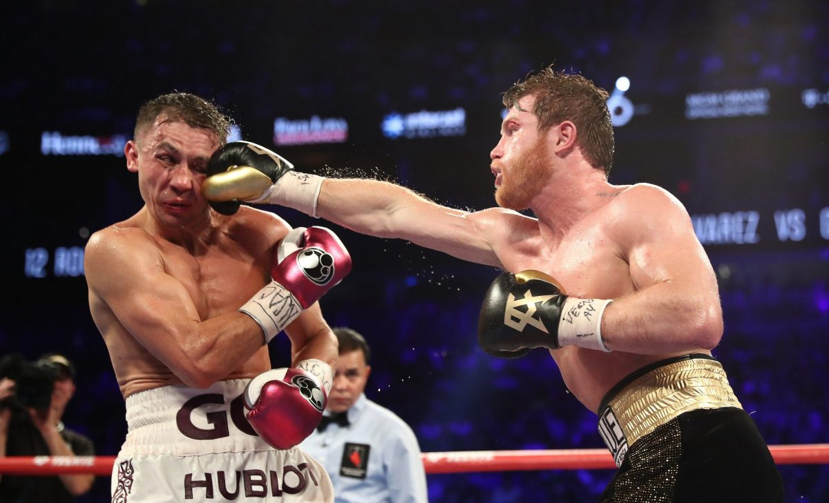 """During arguably boxing's biggest fight of 2018, Canelo Alvarez punches Gennady """"GGG"""" Golovkin during their WBC/WBA middleweight title fight at T-Mobile Arena on September 15, 2018 in Las Vegas, Nevada. (Al Bello/Getty Images)"""