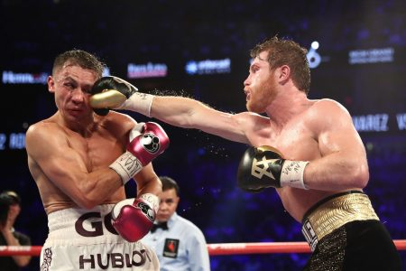 "During arguably boxing's biggest fight of 2018, Canelo Alvarez punches Gennady ""GGG"" Golovkin during their WBC/WBA middleweight title fight at T-Mobile Arena on September 15, 2018 in Las Vegas, Nevada. (Al Bello/Getty Images)"