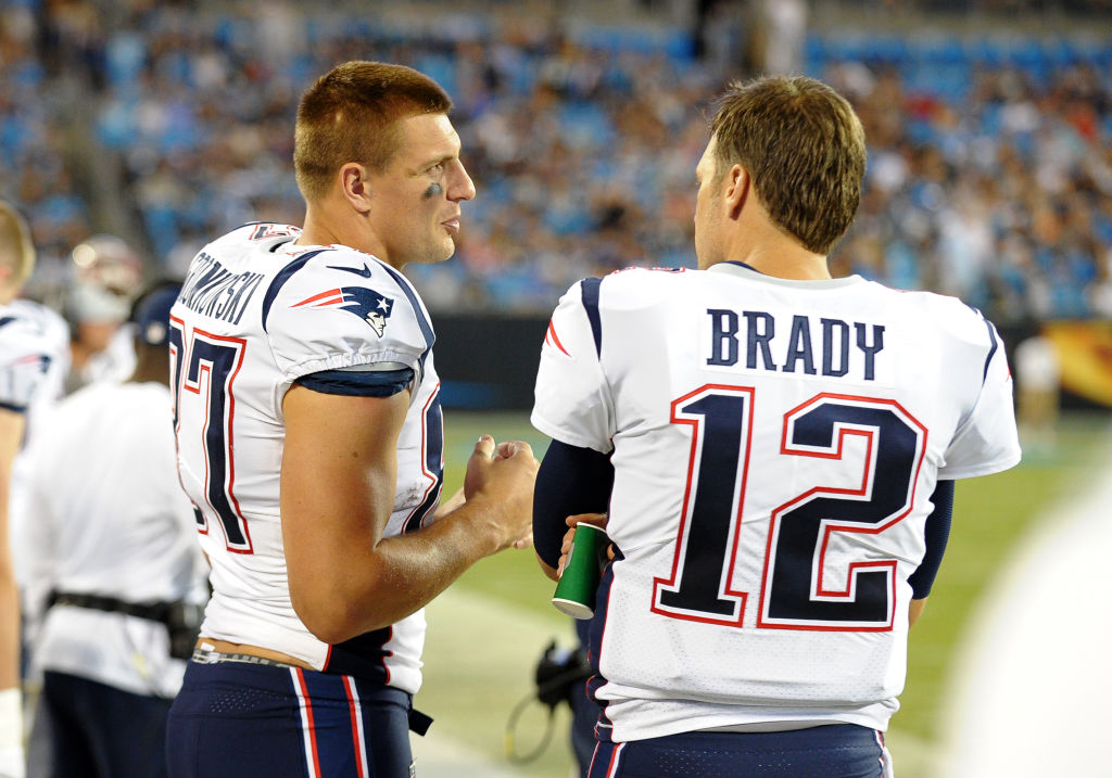 CHARLOTTE, NC - AUGUST 24: New England Patriots tight end Rob Gronkowski (87) and New England Patriots quarterback Tom Brady (12) talk on the sideline during a preseason game between the New England Patriots and the Carolina Panthers on August 24, 2018 at Bank of America Stadium in Charlotte,NC. (Photo by Dannie Walls/Icon Sportswire via Getty Images)