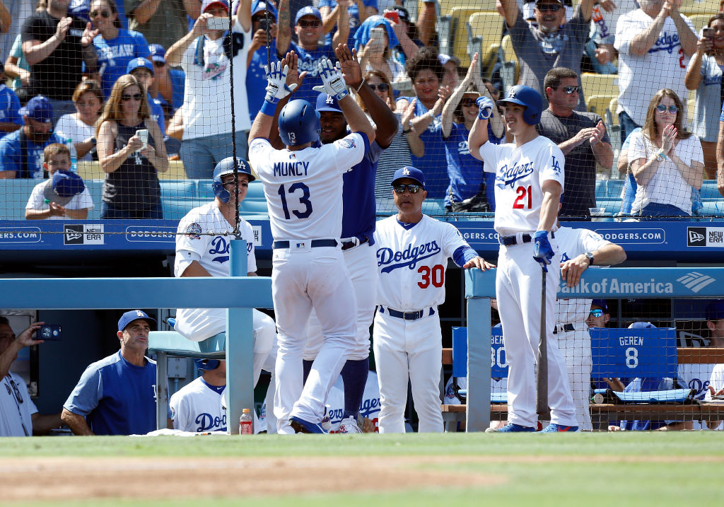 Los Angeles Dodgers infield Max Muncy (13) gets congratulated by Los Angeles Dodgers right fielder Yasiel Puig (66), manager Dave Roberts ( 30 ), and Los Angeles Dodgers pitcher Walker Buehler (21) after Muncy hit a solo home run during the game against the Arizona Diamondbacks on September 02, 2018, at Dodger Stadium in Los Angeles, CA. (Photo by Adam Davis/Icon Sportswire via Getty Images)