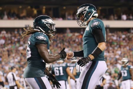 Jay Ajayi #26 of the Philadelphia Eagles celebrates with Nick Foles #9 after rushing for a 1-yard touchdown during the third quarter against the Atlanta Falcons at Lincoln Financial Field on September 6, 2018 in Philadelphia, Pennsylvania. (Photo by Mitchell Leff/Getty Images)