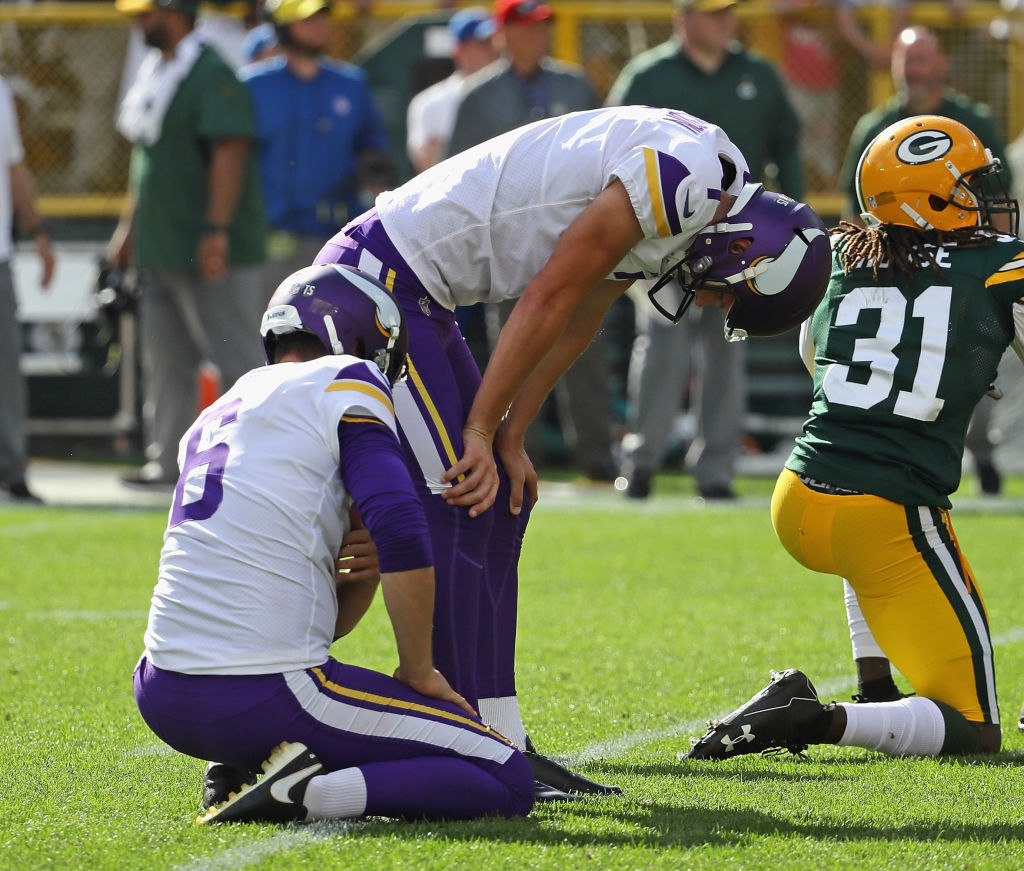 GREEN BAY, WI - SEPTEMBER 16: Daniel Carlson #7 of the Minnesota Vikings (R) reacts after missing a potential game-winning field goal in overtime against the Green Bay Packers  at Lambeau Field on September 16, 2018 in Green Bay, Wisconsin. The Vikings and the Packers tied 29-29 after overtime. (Photo by Jonathan Daniel/Getty Images)