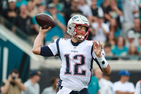 JACKSONVILLE, FL - SEPTEMBER 16: Tom Brady #12 of the New England Patriots drops back to pass against the Jacksonville Jaguars at TIAA Bank Field on September 16, 2018 in Jacksonville, Florida.  (Photo by Scott Halleran/Getty Images)