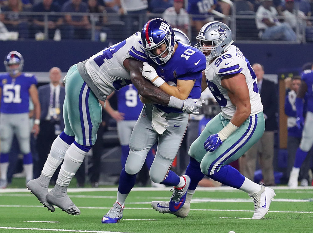 ARLINGTON, TX - SEPTEMBER 16:  Jaylon Smith #54 of the Dallas Cowboys hits Eli Manning #10 of the New York Giants in the third quarter at AT&T Stadium on September 16, 2018 in Arlington, Texas.  (Photo by Tom Pennington/Getty Images)