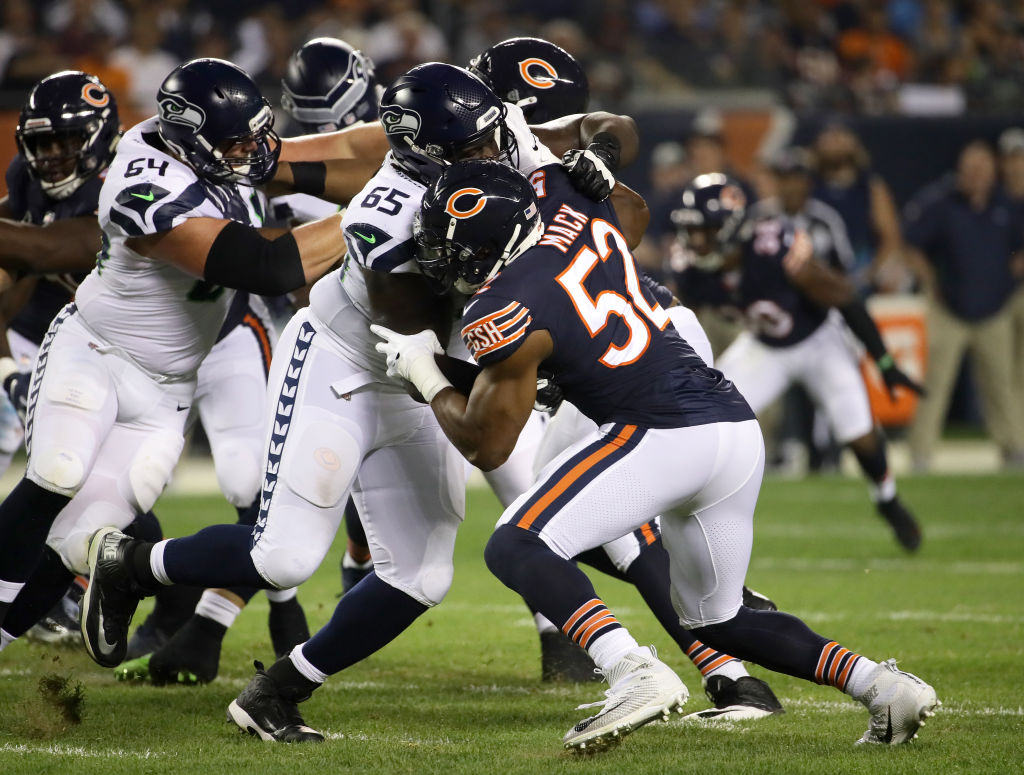 CHICAGO, IL - SEPTEMBER 17: Khalil Mack #52 of the Chicago Bears runs against Germain Ifedi #65 of the Seattle Seahawks in the first quarter at Soldier Field on September 17, 2018 in Chicago, Illinois. (Photo by Jonathan Daniel/Getty Images)