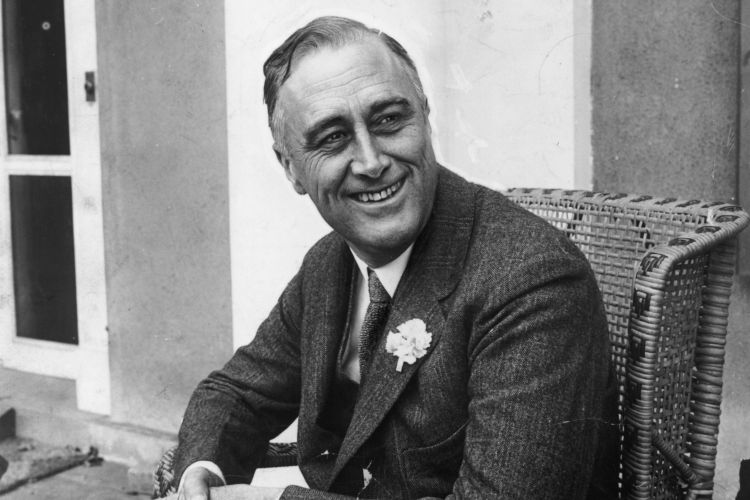 American statesman Franklin Delano Roosevelt (1882 - 1945) smiling when he heard that he was leading the contest for Governor of New York State. He later became the 32nd President of the USA.  (Photo by Hulton Archive/Getty Images)