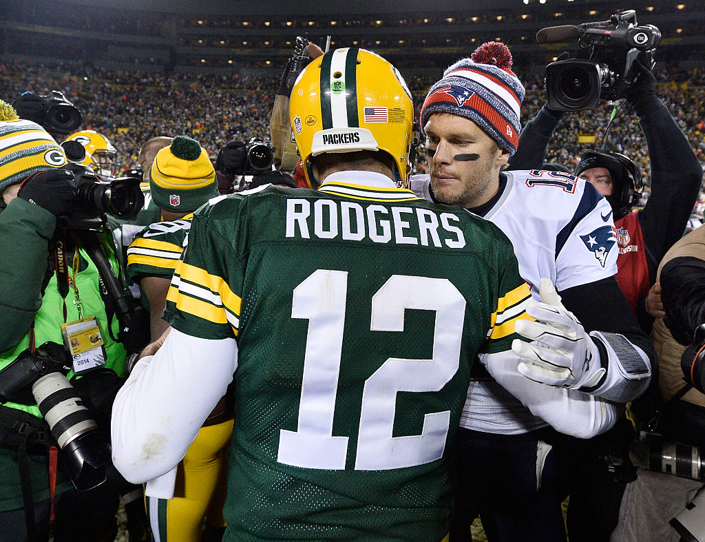 GREEN BAY, WI - NOVEMBER 30:  Tom Brady #12 of the New England Patriots (R) congratulates fellow quarterback Aaron Rodgers #12 of the Green Bay Packers after their game at Lambeau Field on November 30, 2014 in Green Bay, Wisconsin.  The Packers defeated the Patriots 26-21. (Photo by Brian D. Kersey/Getty Images)